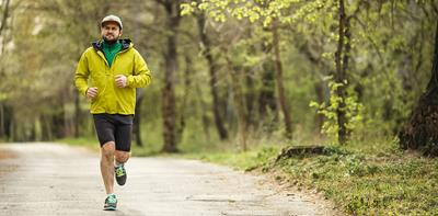 man running jogging yellow jacket shorts cap