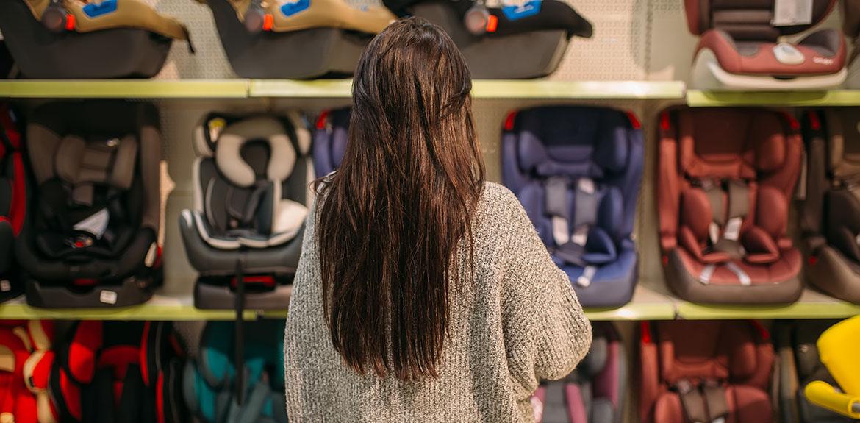 woman shop child car seats