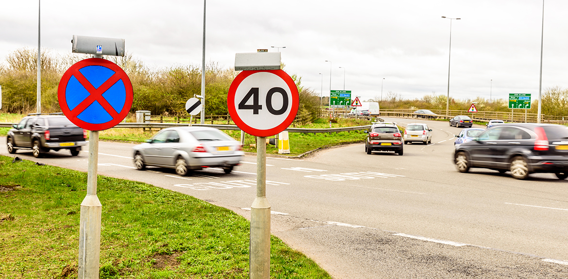 Cars driving into 40 mph speed limit zone