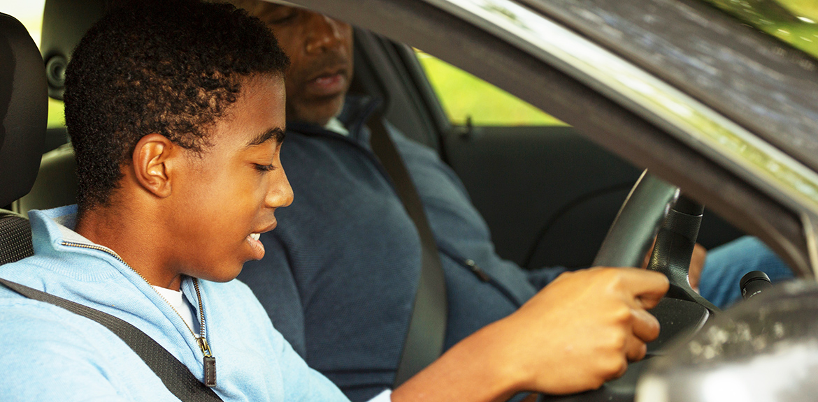 Learner driver in car with dad