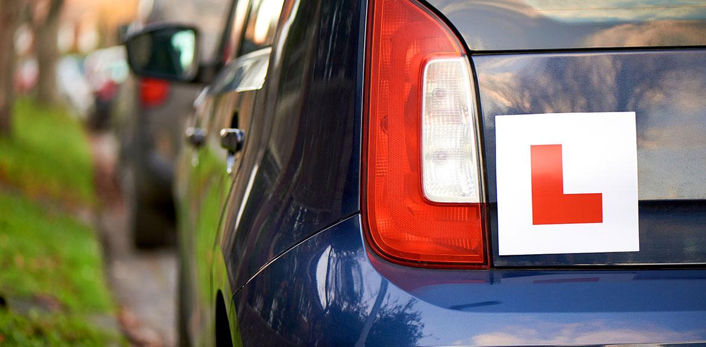 L plates blue car