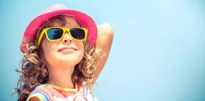 young girl wearing sunglasses on sunny holiday