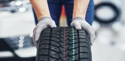 man rolling tyre