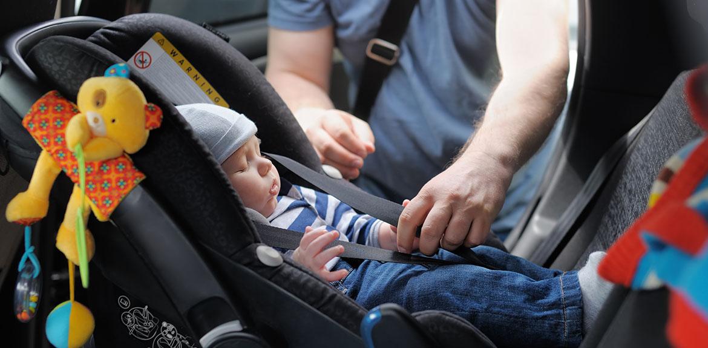 toddler girl in car seat