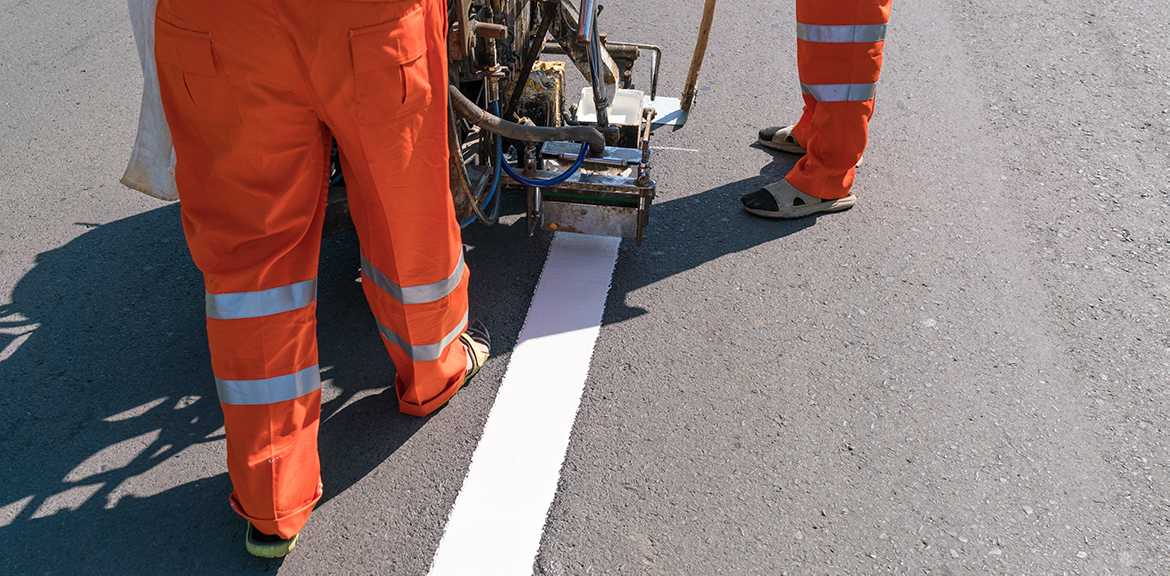 white line markings on road being painted