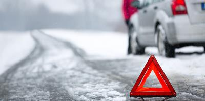 car broken down in winter on snowy road